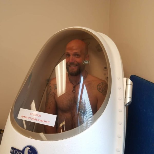 Ted in a bod-pod, testing body composition as part of an in-depth fitness test